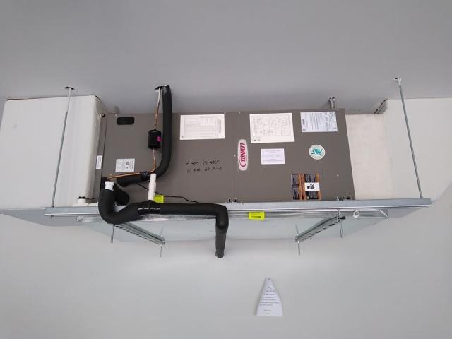 Custom garage air conditioner installation.