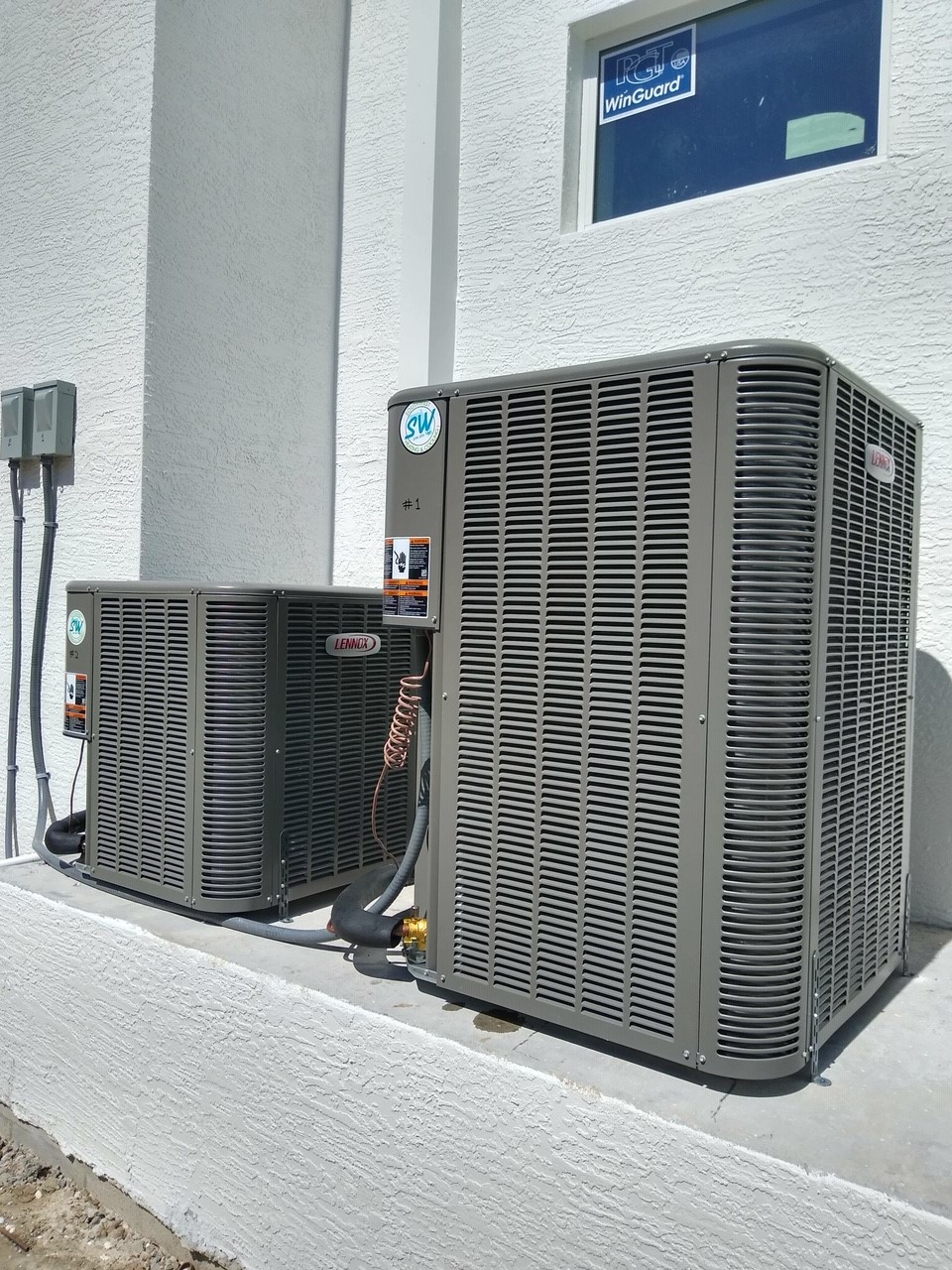 Both condensers leveled and strapped for weather. High quality installation.