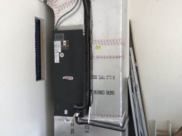 Custom garage air conditioner installation.